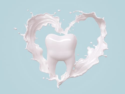 tooth surrounded by milk