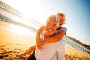 elderly couple smiling beach